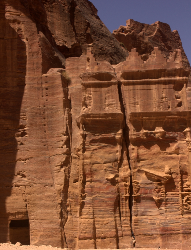 Rock cut red sandstone tombs lined